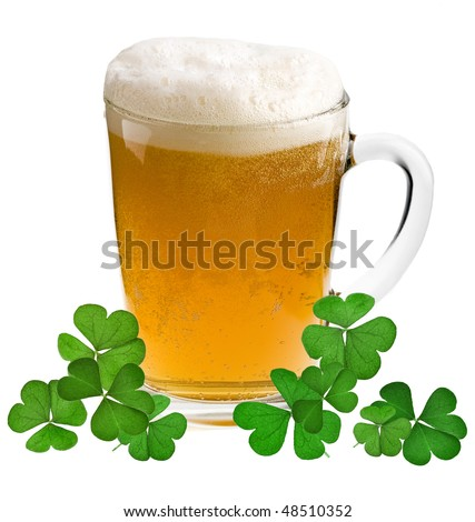 Shamrock clover and beer - - symbol of holiday St Patrick's Day - stock photo