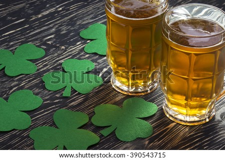 Shamrock clover and beer -symbol of St Patrick's Day - stock photo