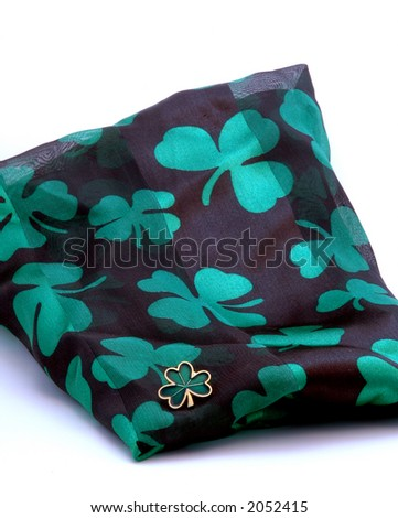 Shamrock Scarf, and shamrock pin, all waiting to be worn for St. Patrick's Day.