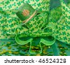 Shamrock shaped cookie cutter with mini hat on it with confetti and decorative ribbon - stock photo