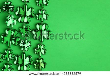 Shamrock Shaped Shiny Leaves over Green. St. Patrick's Day - stock photo