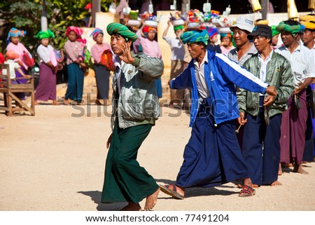 SHAN STATE, MYANMAR - FEBRUARY 03: Festival in honour of young boys who are becoming novice monks on February 3, 2011 in Ti Daing monastery in Pa'O people's village, Shan state of Myanmar. - stock photo