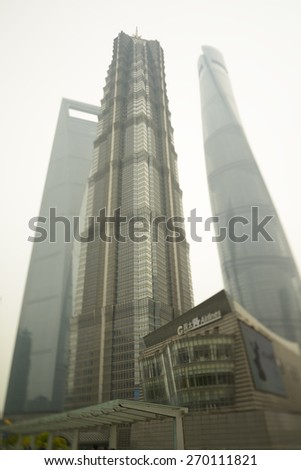 SHANGHAI-APRIL 16, 2015. Jin Mao, new Shanghai Tower and Shanghai World Financial Center at Lujiazui (financial & trade zone designated by the Chinese government) on April 17, 2015 in Shanghai. - stock photo
