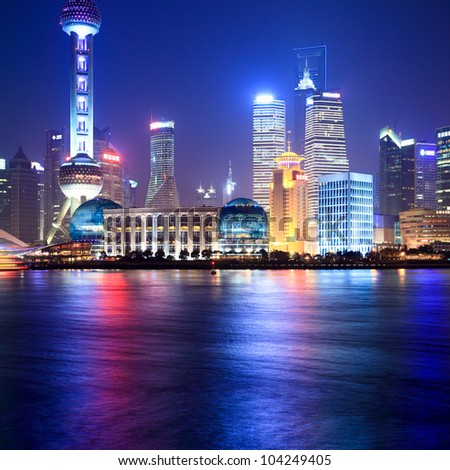 shanghai at night beside the huangpu river - stock photo