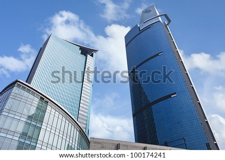 SHANGHAI-AUG. 23, 2009 13, Skyscrapers with glass surface on Aug. 23. 2009 in Shanghai. China has a booming skyscraper industry. Currently 34% of the world 100 tallest buildings are located in China. - stock photo