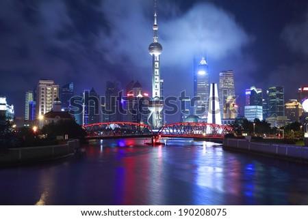 Shanghai bund garden bridge and lujiazui of skyline at night  - stock photo