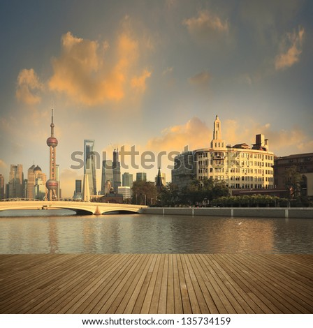 Shanghai bund landmark skyline prospects of wood floor corridor at urban buildings landscape - stock photo