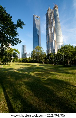 Shanghai, China - A beautiful nature view of Shanghai tallest building with the Shanghai tower still in construction.  - stock photo