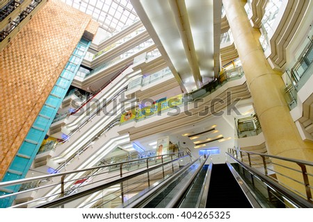 SHANGHAI, CHINA - APR 3, 2016: Interior of the New World Emporium shopping center in Shanghai, China,  located at the Nanjing Road.