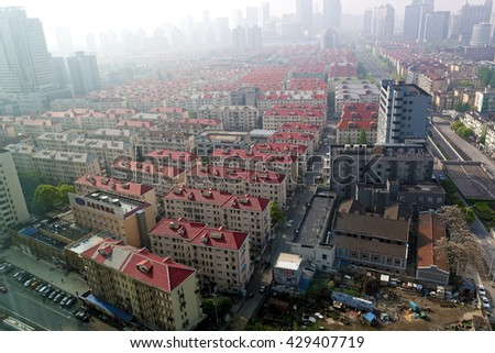 SHANGHAI, CHINA - April 16, 2016: Areal view of the Shanghai rooftops in the early foggy morning. WHO recently classified Shanghai air pollution to be a number one carcinogen.  - stock photo