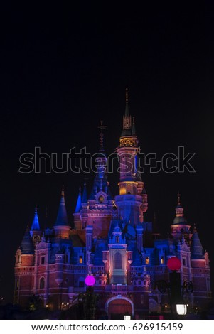 SHANGHAI, China. April 21, 2017: Colorful fairy tale castle at night in Shanghai Disneyland