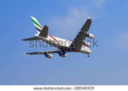 SHANGHAI, CHINA, April 2, 2015: Emirates Airline Airbus A380 (A6-EEC)flying in the sky. Airbus A380 is the world's biggest jet airliner - stock photo