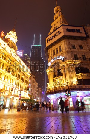 SHANGHAI, CHINA - APRIL 12, 2014: Famous pedestrian Nanjing Road at night - stock photo
