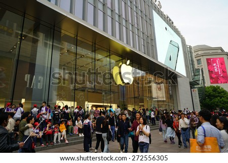 SHANGHAI CHINA - APRIL 25, 2015: Nanjing Road in the weekend in Shanghai.Nanjing Road is the main shopping street of Shanghai and here is one of the world's busiest shopping streets.  - stock photo