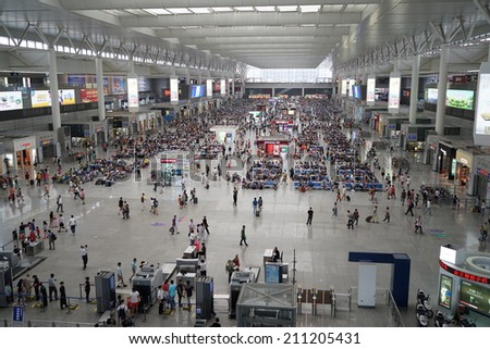 SHANGHAI, CHINA - August 16: crowd of passengers waits for a transport on one of the four major railway stations in Shanghai - Shanghai Hongqiao Railway Station on August 16. 2014 in Shanghai