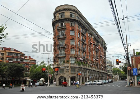 SHANGHAI, CHINA-AUGUST 18, 2013: the old Wukan building in the Xuhui district. Ths is one of the historical city building. - stock photo