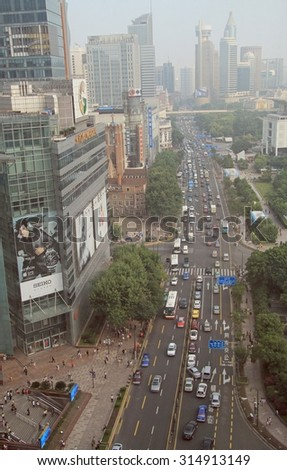 SHANGHAI, CHINA - JULY 1, 2015: people are driving cars in the center of Shanghai