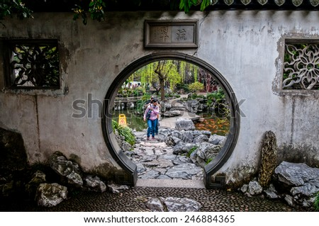 SHANGHAI, CHINA - MARCH 22: Chinese tourists visiting YuYuan Garden - one of the most famous tourists attraction of Shanghai on March 22, 2013 in Shanghai - stock photo