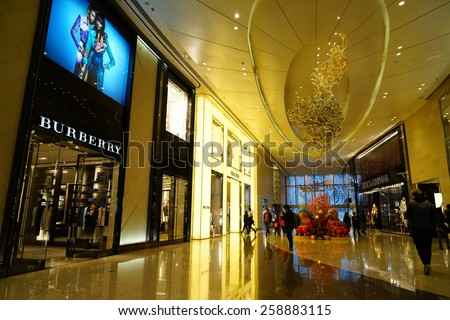 SHANGHAI, CHINA - March 8. 2015: Interior of the IFC Shopping Mall downtown in Pudong Lujiazui. BURBERRY inside Just The international women's day at March 8. 2015 Shanghai, China - stock photo