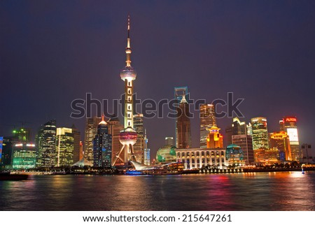 SHANGHAI, CHINA-MARCH 29, 2010: night view of Pudong riverfront buildings and the pearl tower. one of the most famous tourist destinations in Shanghai - stock photo