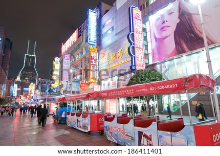 SHANGHAI, CHINA - MARCH 20: Tourists and residents walks at main pedestrian shopping street Nanjing Road on March 20, 2013 in Shanghai - stock photo