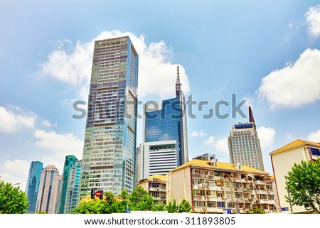 SHANGHAI, CHINA- MAY, 24, 2015:Beautiful skyscrapers, city building, office and commercial buildings in the Pudong business part of modern Shanghai - the financial capital of the Republic of China.