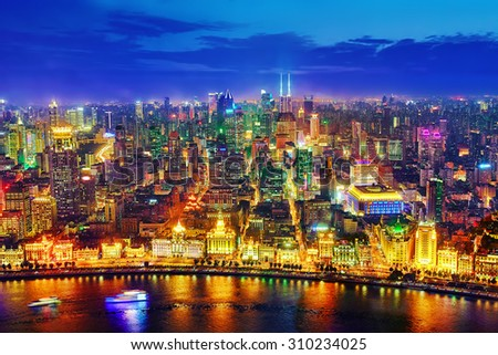 SHANGHAI, CHINA - MAY 23, 2015:Beautiful view of  Shanghai -  Bund or Waitan waterfront at night. Shanghai waterfront Bund has historical buildings and it is one of the most famous tourist place.