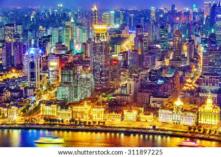 SHANGHAI, CHINA - MAY 23, 2015:Beautiful view of  Shanghai -  Bund or Waitan waterfront at night. Shanghai waterfront Bund has historical buildings and it is one of the most famous tourist place. - stock photo