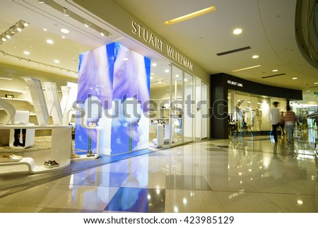 Shanghai.China-MAY,17,2016: Modern shopping mall interior.Multi luxury brand inside.In shanghai downtown China. - stock photo