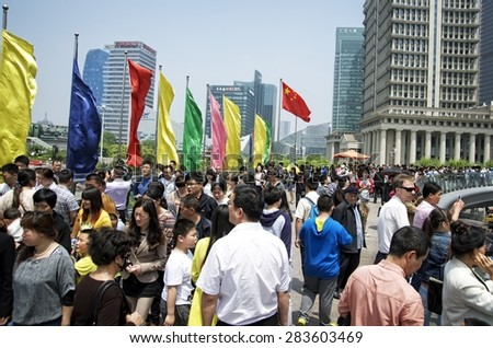SHANGHAI, CHINA - MAY 2, 2015: Tourists and locals in Pudong. Pudong is home to the Lujiazui Finance and Trade Zone and the Shanghai Stock Exchange and many of Shanghai's best-known buildings. - stock photo