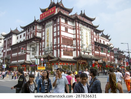 SHANGHAI, CHINA - MAY 8, 2015: Traditional district of commerce in the city, surrounding the City God Temple, or Chenghuang Miao, in the northeast of the Old City of Shanghai, a famous landmark. - stock photo