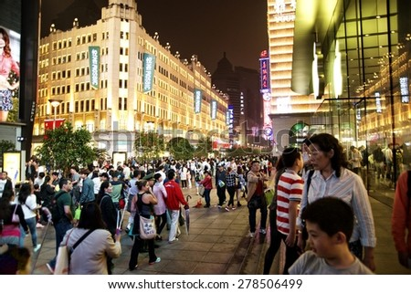 SHANGHAI, CHINA - MAY 2, 2015: Visitors at Nanjing Road. It is the main shopping street of Shanghai, China, and is one of the world's busiest shopping streets.