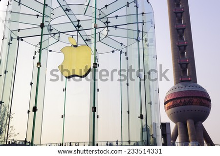 Shanghai, China - Nov 20, 2014: Apple store and Oriental Pearl Tower in Lujiazui Financial District, Pudong Shanghai, China - stock photo