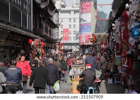 SHANGHAI, CHINA - NOV 23: Busy street in the old town of Shanghai. November 23, 2010, in Shanghai, China