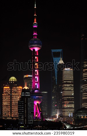 SHANGHAI, CHINA - NOV 20, 2014: Night shot featuring the magnificent Oriental Pearl Tower and Shanghai World Financial Center of Shanghai, a global financial center and busy container port. - stock photo