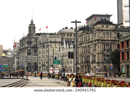 SHANGHAI, CHINA - NOV 17, 2014: The historic buildings of The Bund, a major financial center containing many banks on the Huangpu River, is a famous tourist attraction in Shanghai. - stock photo