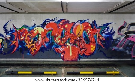 SHANGHAI, CHINA -15 NOVEMBER 2015- Colored street art wall murals in the parking garage of the Radisson hotel in Pudong, Shanghai, China.