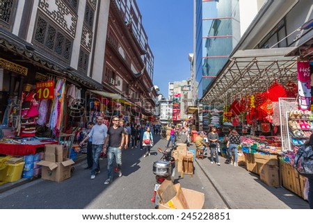 SHANGHAI, CHINA - OCT 24, 2014: Chinese shopping streets around Yuyuan Market in Shanghai, China. It's located next to famous Yuyuan Garden. There are over ten shopping streets in this market.  - stock photo