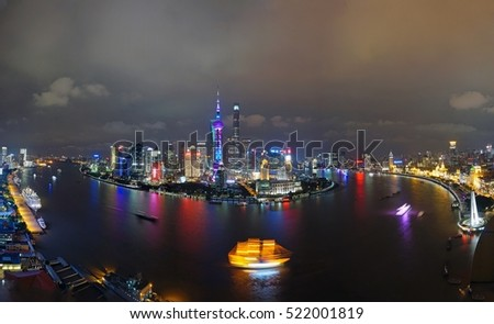 SHANGHAI, CHINA -16 OCTOBER 2016- A night view of the modern Pudong skyline across the Bund in Shanghai, China. Shanghai is the largest Chinese city.