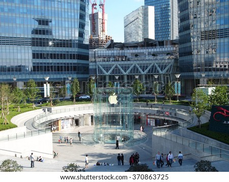 Shanghai, China - October 18, 2011: Apple Store Pudong Branch is the 2nd Apple store in China. It opened in 2010 with a style of giant glass cylinder that sits above ground as an entrance.       - stock photo