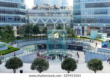 Shanghai, China - October 3, 2015: Apple store seen from the outside in Lujiazui, downtown Shanghai. Many people buying the New product inside the Apple Store. - stock photo