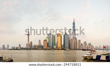 SHANGHAI, CHINA - OCTOBER 20, 2013: Panoramic view of Lujiazui and financial district skyscrapers from the Bund, in Shanghai, China, at sunset