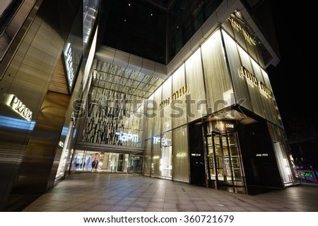 SHANGHAI, CHINA - Sept. JAN,9,2016: Miu Miu store at night. Miu Miu is Prada's secret weapon to win China's young luxury shoppers with its edgier image is propelling Prada's growth. - stock photo