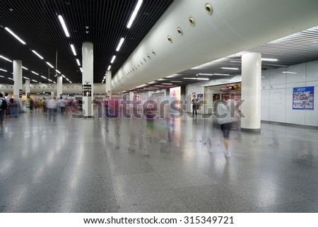 Shanghai.China-Sept. 3rd.2015;The scene of shanghai subway station,passengers motion blur.Just China public holiday.Shanghai Metro system is the world's largest rapid transit system by route length.