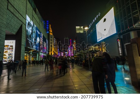 SHANGHAI, CHINA - 28th MARCH 2014: Nanjing road, a shopping mecca comes to life when night time arrives. - stock photo