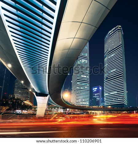 Shanghai City center at night with light trails - stock photo