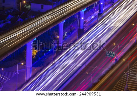 shanghai city traffic in night with car lamp track - stock photo