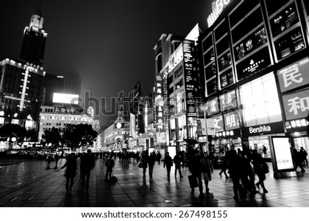 SHANGHAI, CN - MAR 17 2015:Visitors at Nanjing Road. It is the main shopping street of Shanghai, China, and is one of the world's busiest shopping streets. - stock photo