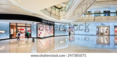SHANGHAI-DEC. 2, 2014. Louis Vuitton at IFC shopping mall. Although big fashion labels losing their luster among Chinese consumers, ContactLab study finds Louis Vuitton top of list for brand awareness - stock photo