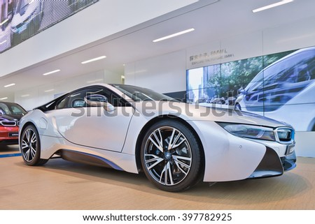 SHANGHAI-DEC. 9, 2014. New BMW i8 sports-car. The i8 is an intelligent lightweight constructed plug-in hybrid sports-car with an acceleration of 0-100 km/h 4.4 seconds and a top speed of 250 km/h. - stock photo